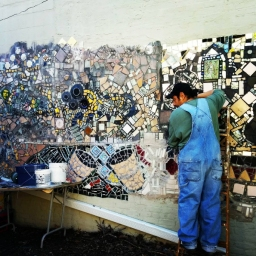 Artist Carlos Pinto, working on the Q Gardens mural