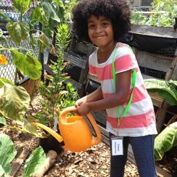Kiddie Science member, watering plants